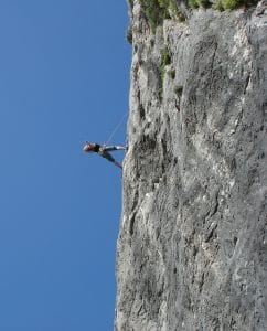 climber on a rock face. Well equipped but progress is rocky