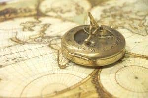 Old maps and compass to navigate synchronicity
