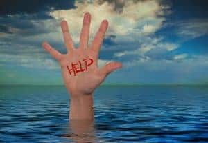 hand reaching out of water with help sign to relieve anxiety