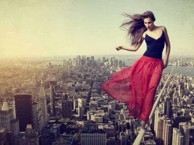 balance woman on tightrope